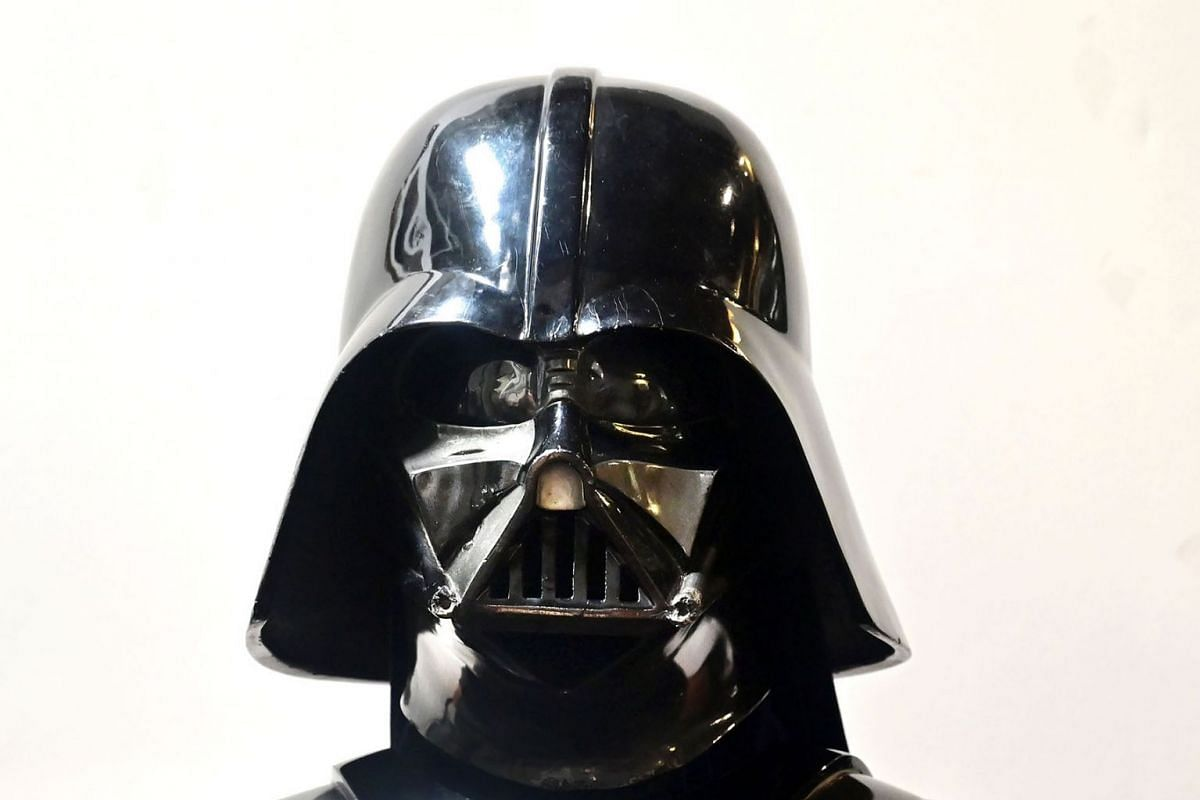 """A Darth Vader helmet and mask from the film """"The Empire Strikes Back"""" on display at the Profiles in History auction house on August 28, 2019, in Calabasas, California ahead of """"The Icons and Legends of Hollywood Auction"""" on September 25 and 26. PHOTO"""