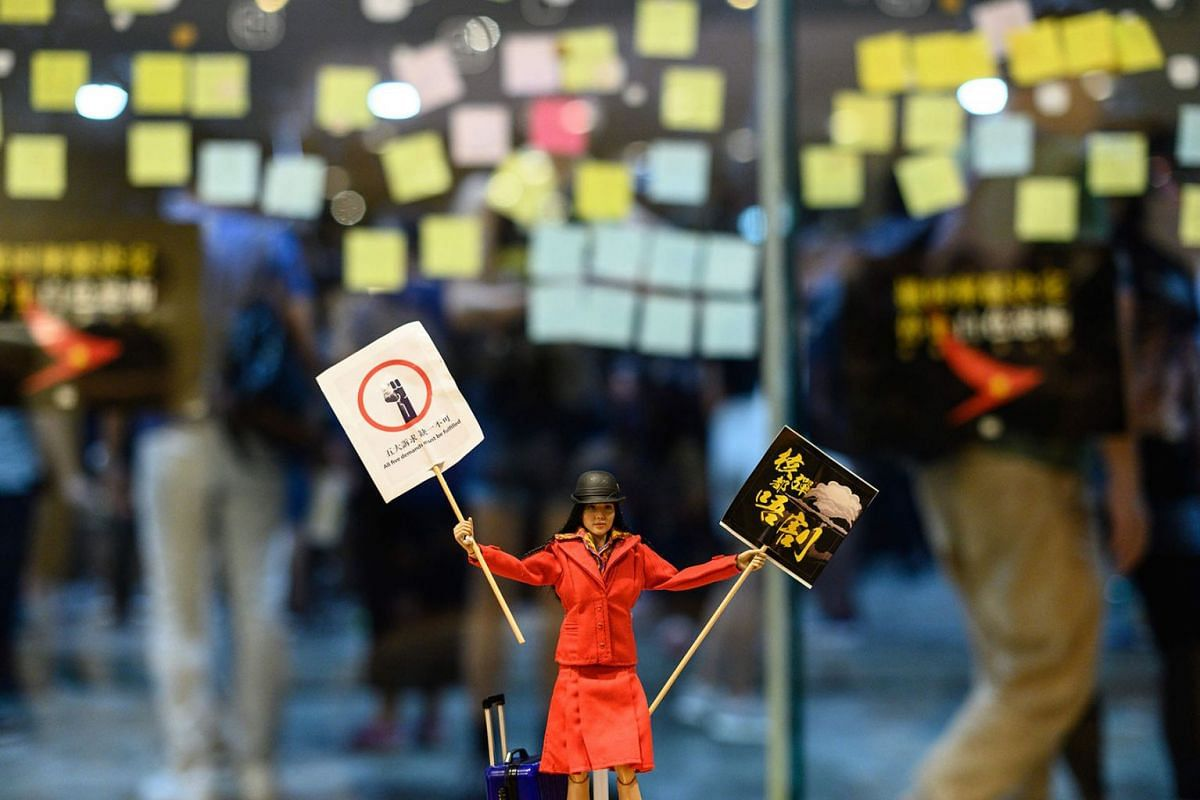 A flight attendant doll is placed inside a shopping mall during a rally to support Cathay Pacific staff in Hong Kong on August 28, 2019. PHOTO: AFP