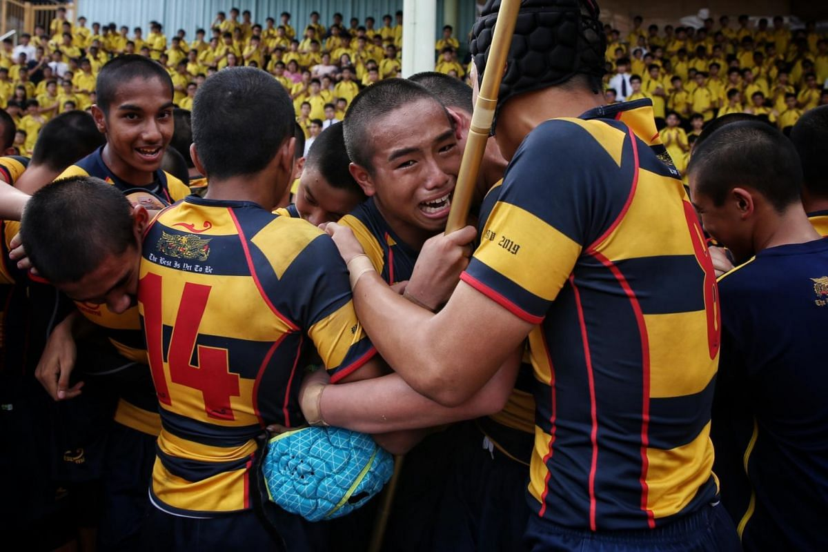 Tycen Yeoh (centre, facing camera) of ACS(I) celebrates with teammates after defeating St Andrew's in the Boys' C Division rugby finals at Queenstown Stadium on Aug 29, 2019.
