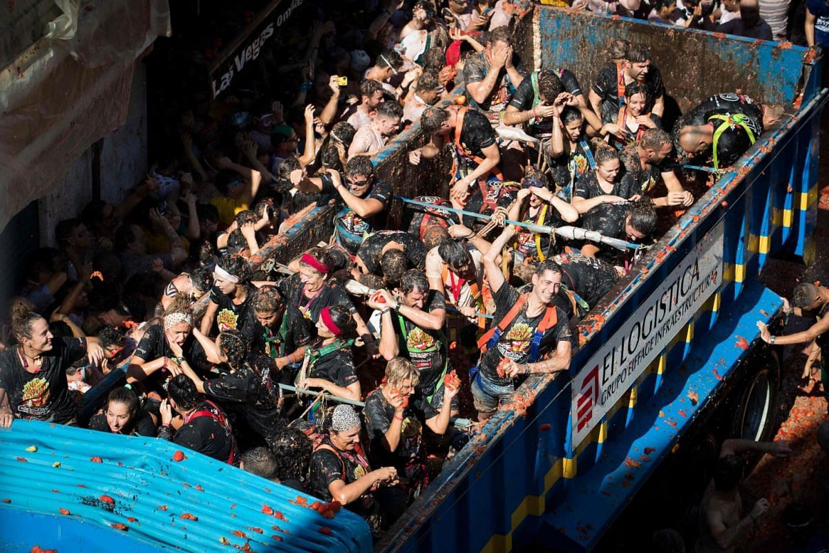 Revellers in a truck throw tomatos at the annual La Tomatina festival in the eastern town of Bunol, on Aug 28, 2019.