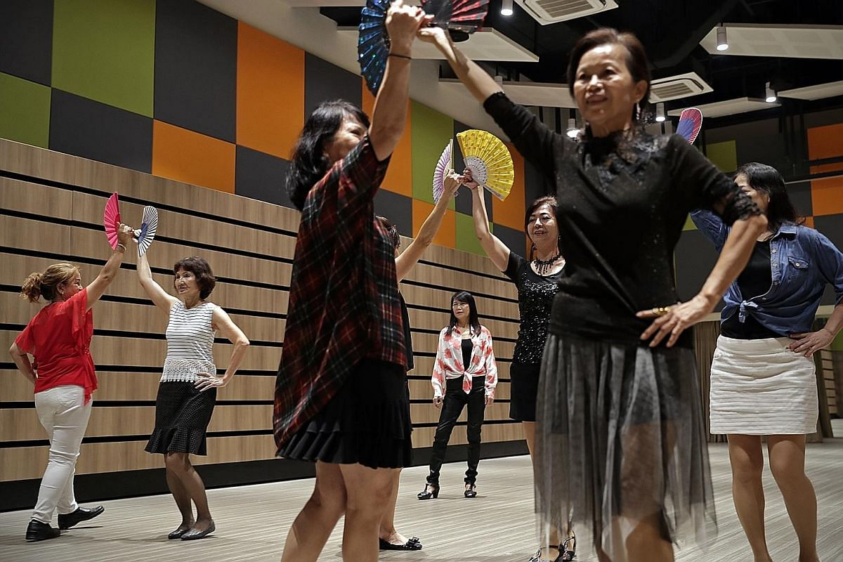 Madam Cheang (centre) watching the women rehearse a dance. The grandmother of one leads the group in simple dance and aerobics movements during their weekly sessions to keep everyone active
