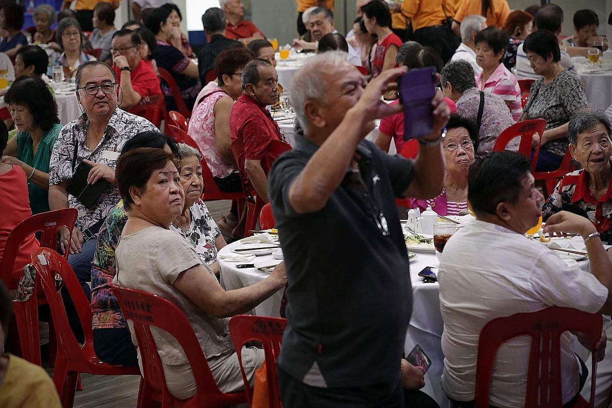 Residents of the community attending the Teck Ghee Wellness National Day Celebration Lunch where they watched a fashion show by the modelling interest group on stage on Aug 18.