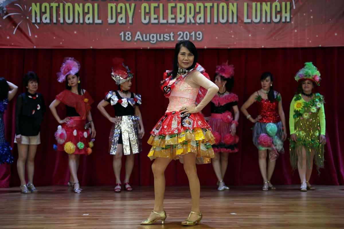 Madam Wendy Cheang (centre) leads the Teck Ghee CC modelling interest group during a performance at the community club.
