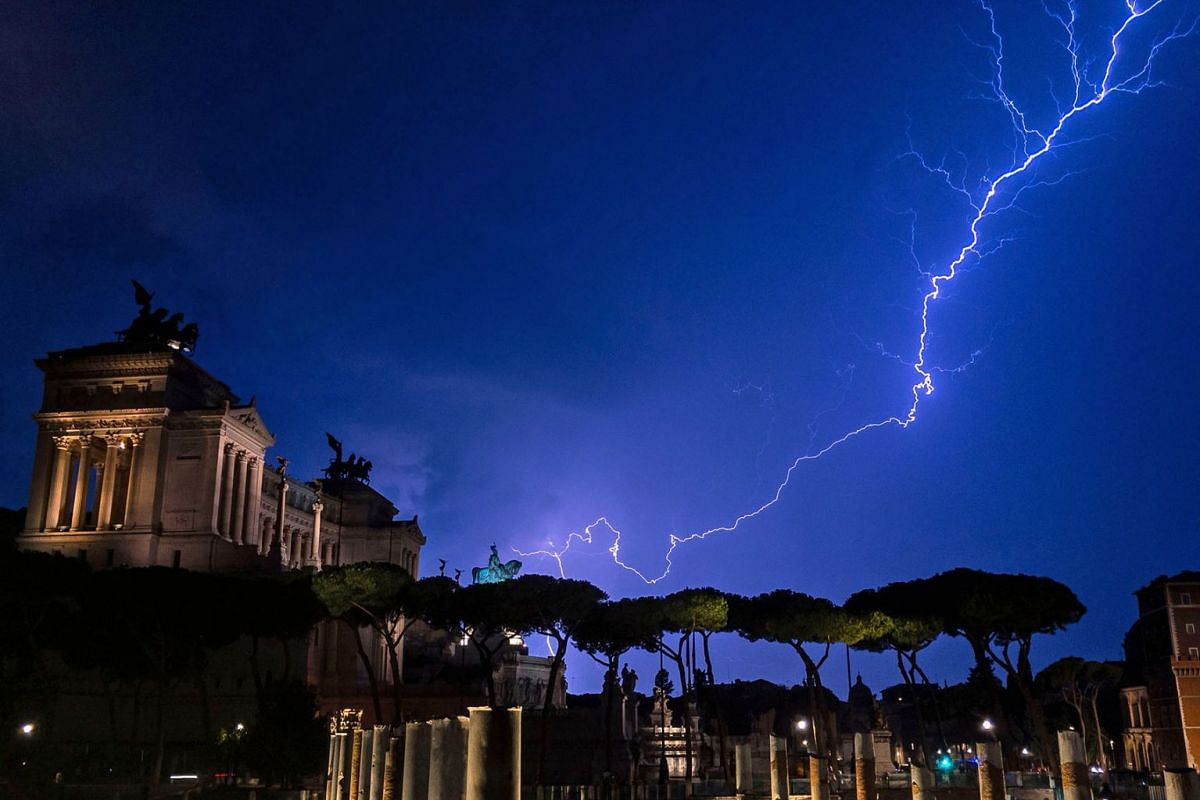 A lightning strikes over the Vittorio Emanuele II monument and its equestrian statue in Rome during a thunderstorm on September 2, 2019. PHOTO: AFP