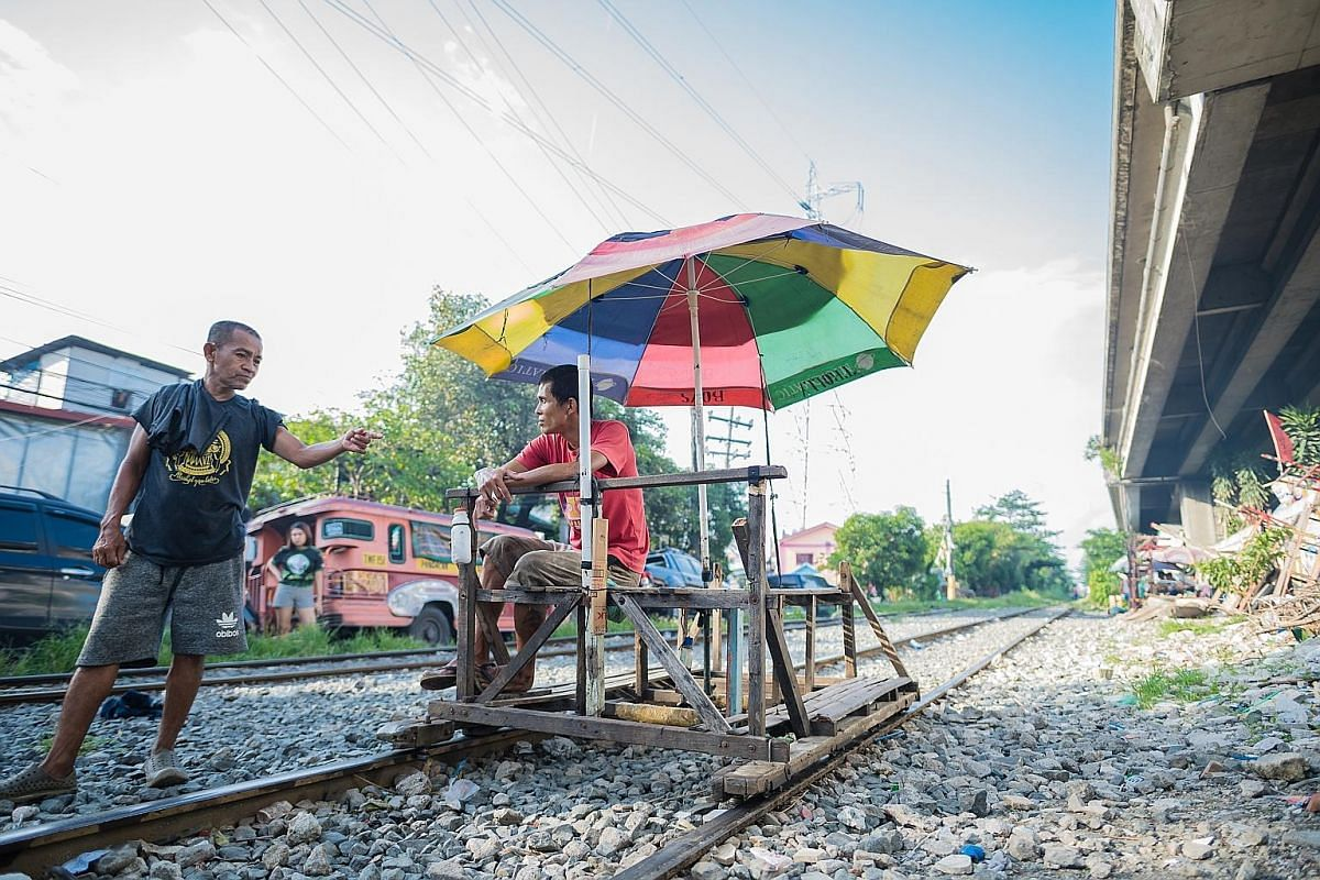Left: Mr Benjie Barbosa, 35, pushed his first trolley in 1999, when he was just 15. He did it for five years, quit to become a farmer but was back pushing trolleys again in 2017. Right: Most trolley boys have never gone past sixth grade. Pushing trol