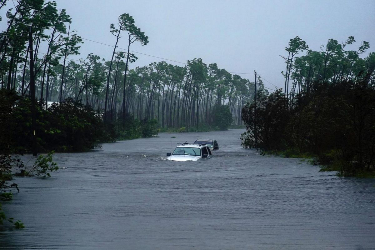 Cars sit submerged in water from Hurricane Dorian in Freeport, Bahamas, on Sept 3, 2019.