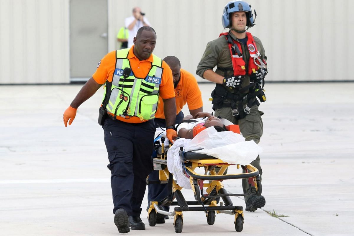 US Coast Guard personnel wheel an evacuee on a stretcher, rescued from Abaco Island after Hurricane Dorian, in Nassau, Bahamas, on Sept 3, 2019.