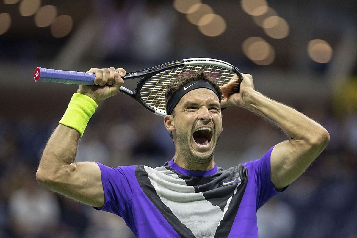 Bulgarian tennis player Grigor Dimitrov celebrates victory after defeating Switzerland's Roger Federer in their men's singles quarter-final tennis match of the 2019 US Open Grand Slam tournament at the Arthur Ashe Stadium on September 3, 2019 in New