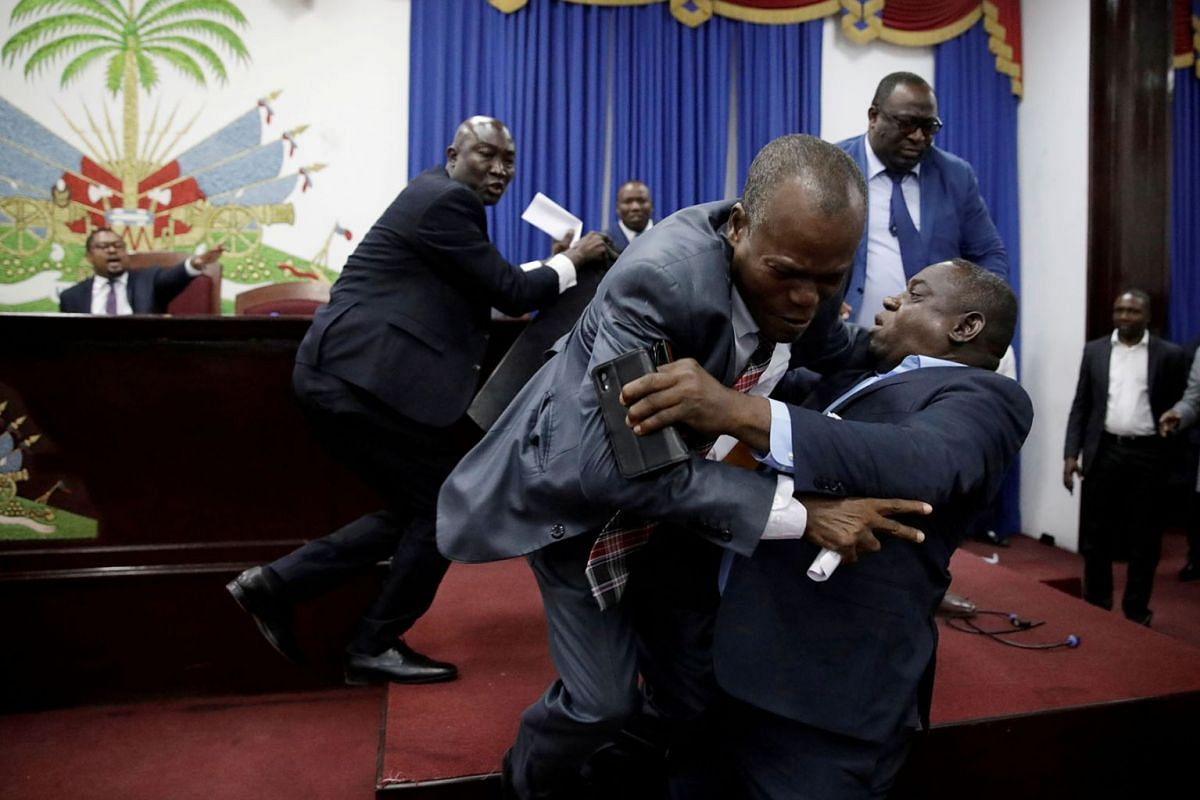 Deputies argue before a session to present the general policy of the appointed Prime Minister Fritz William Michel at the Parliament in Port-au-Prince, Haiti, September 3, 2019. PHOTO: REUTERS