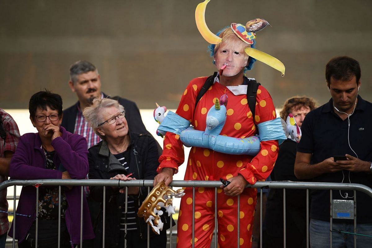 A protester wearing a mask of Britain's Prime Minister Boris Johnson and in fancy dress is seen near the Houses of Parliament in central London on September 4, 2019. PHOTO: AFP