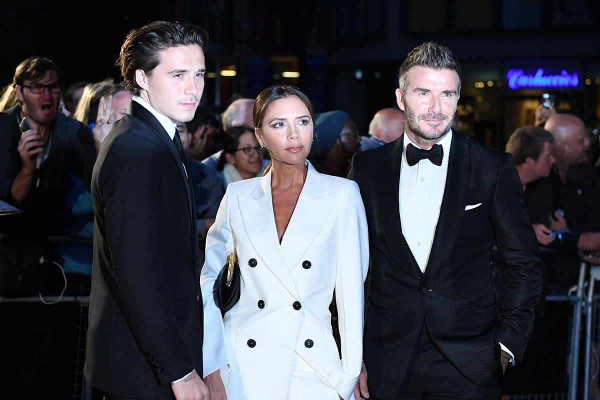 British former soccer player David Beckham (R), his wife, British fashion designer Victoria Beckham (C) and their son, Brooklyn Beckham (L) arrive for the GQ Men Of The Year Awards 2019 ceremony in London, Britain, September 3, 2019. PHOTO: EPA-EFE