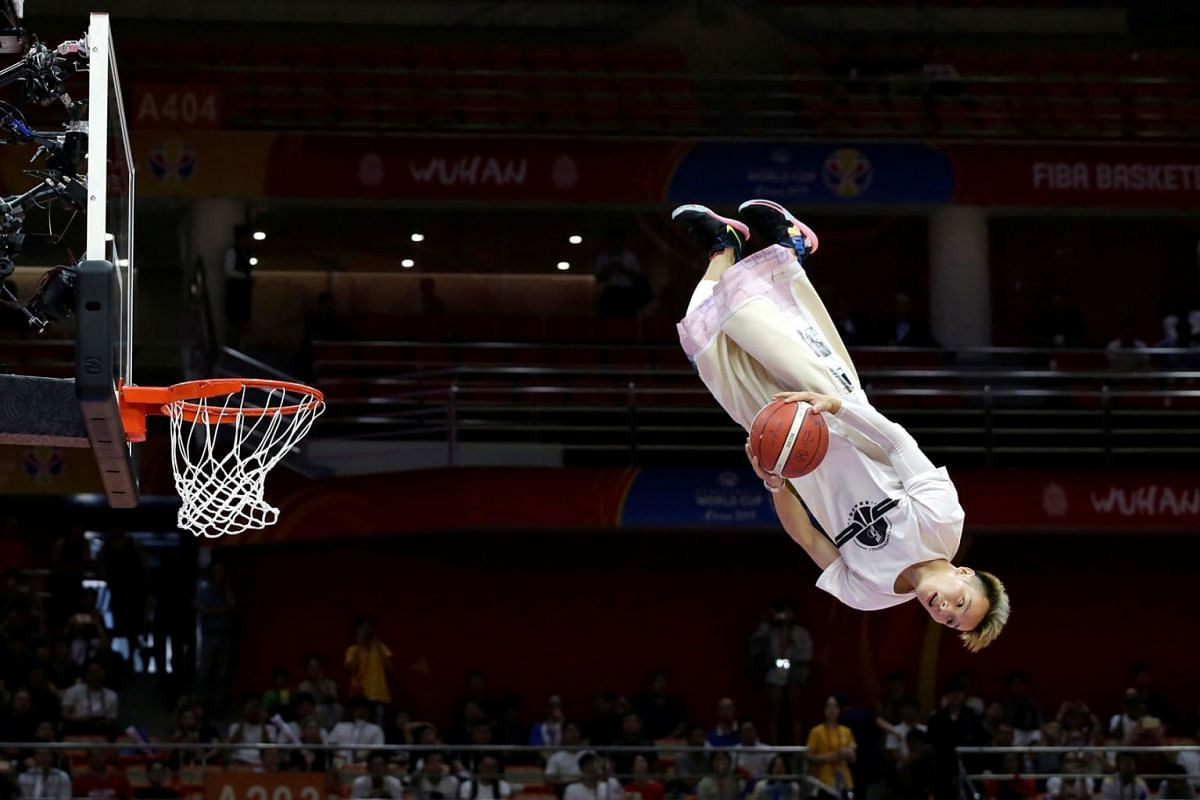 A dunk artist performs during half time at the FIBA Basketball World Cup in Wuhan Sports Centre, Wuhan, China on September 4, 2019. PHOTO: REUTERS