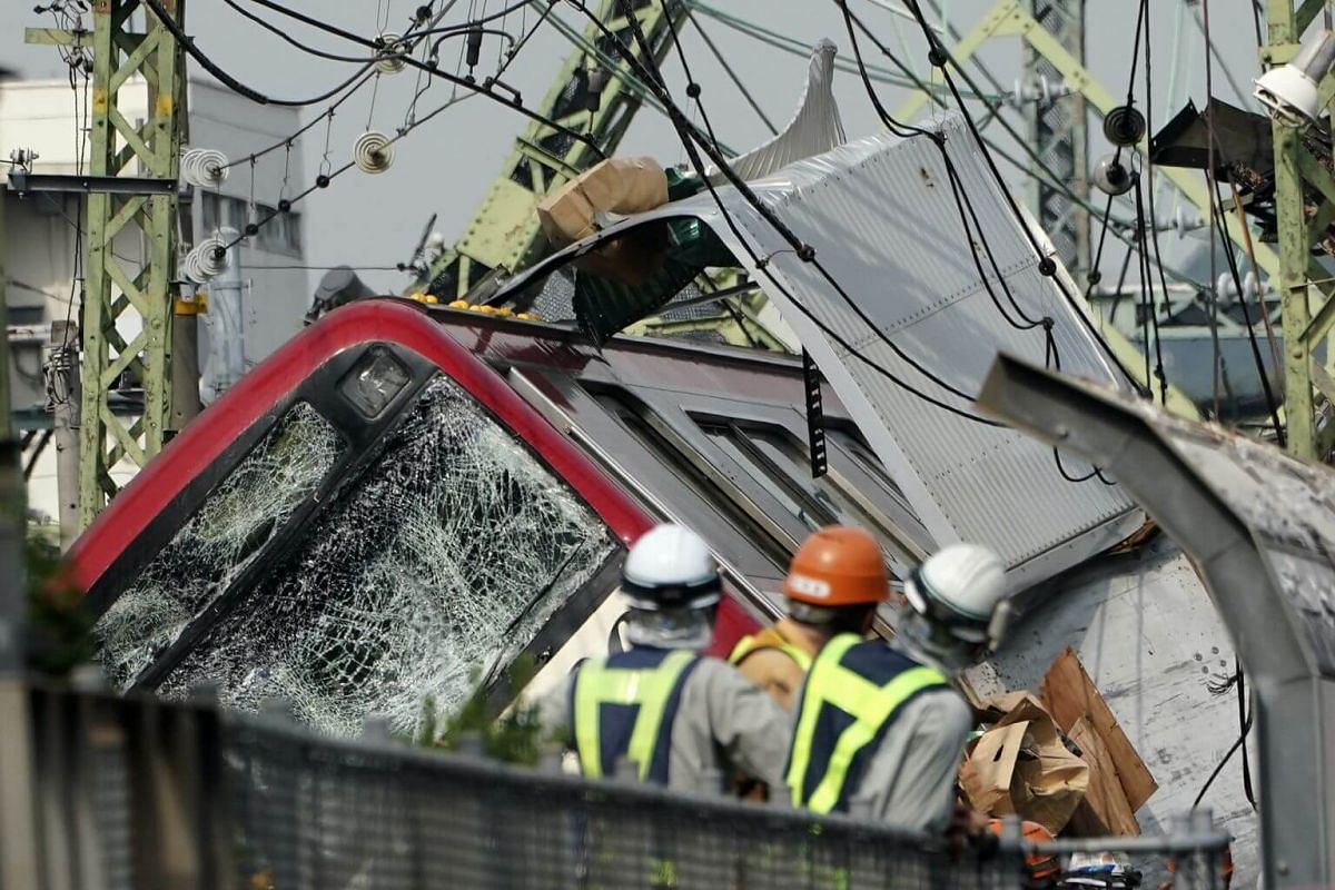The Keikyu express train sits derailed after its collision with a truck in Yokohama, south of Tokyo, on Sept 5, 2019.