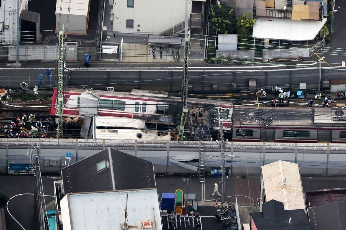 An aerial view shows the derailed train after the collision with a truck at a crossing in Yokohama, Kanagawa Prefecture, on Sept 5, 2019.