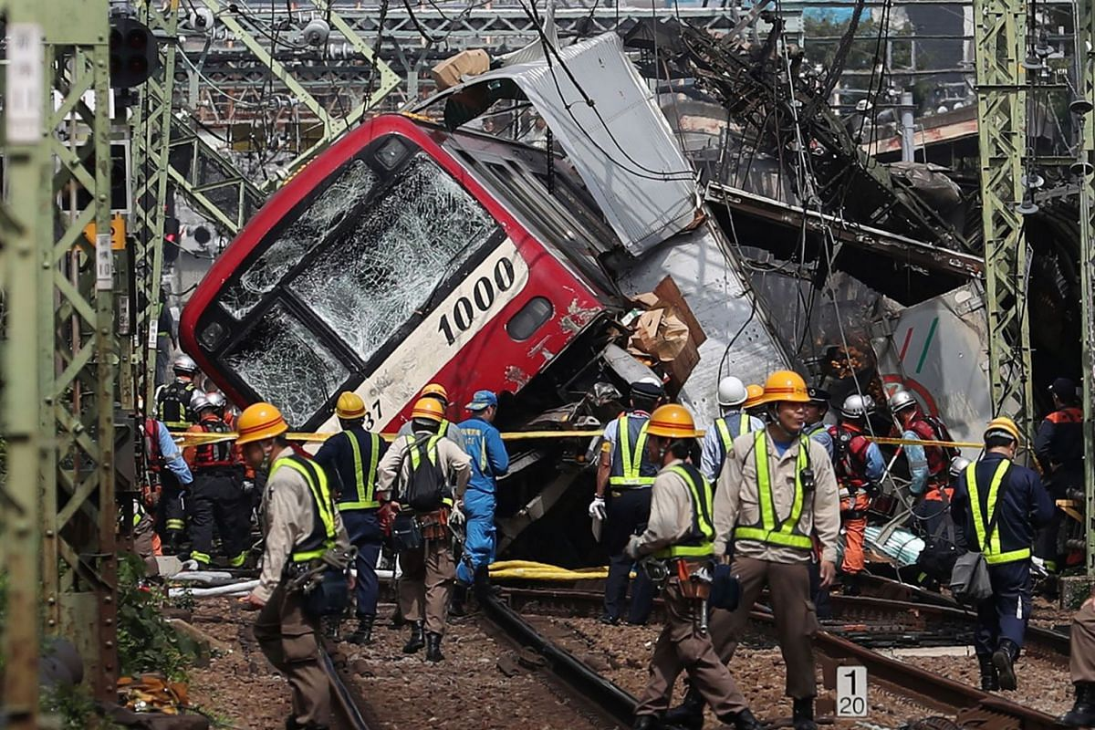 Rescue team work at the crash site, where a train is derailed after a collision with a truck at a crossing in Yokohama, Kanagawa Prefecture on September 5, 2019. PHOTO: JIJI PRESS VIA AFP