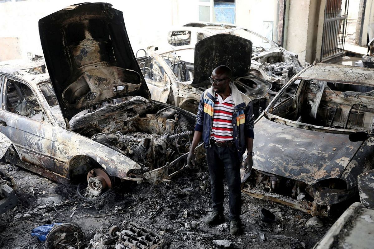 Nigerian entrepreneur Basil Onibo, one of the victims of the latest spate of xenophobic attacks looks at the burnt out cars at his dealership in Johannesburg, South Africa, September 5, 2019. PHOTO: REUTERS