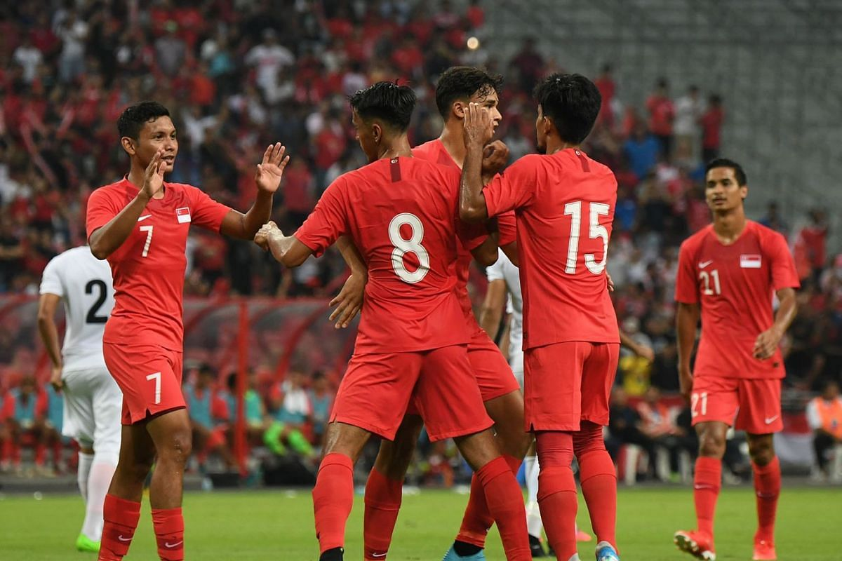 From far left: Zulqarnaen Suzliman, Shahdan Sulaiman and Yasir Hanapi surrounding Ikhsan Fandi to congratulate him after he opened the scoring for Singapore last night, September 5, 2019, against Yemen, with Safuwan Baharudin approaching to join in.