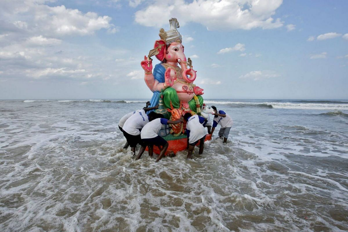 Devotees carry an idol of the Hindu god Ganesh into the Bay of Bengal during the 10-day Ganesh Chaturthi festival in Chennai, India, on Sept 8, 2019.