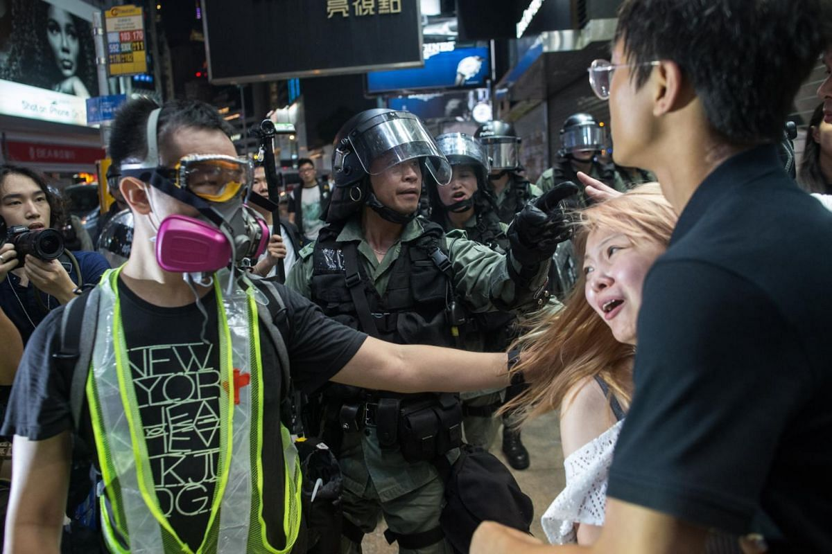 Local residents are asked by police to leave the area after a protest in Causeway Bay, Hong Kong, on Sept 8, 2019.