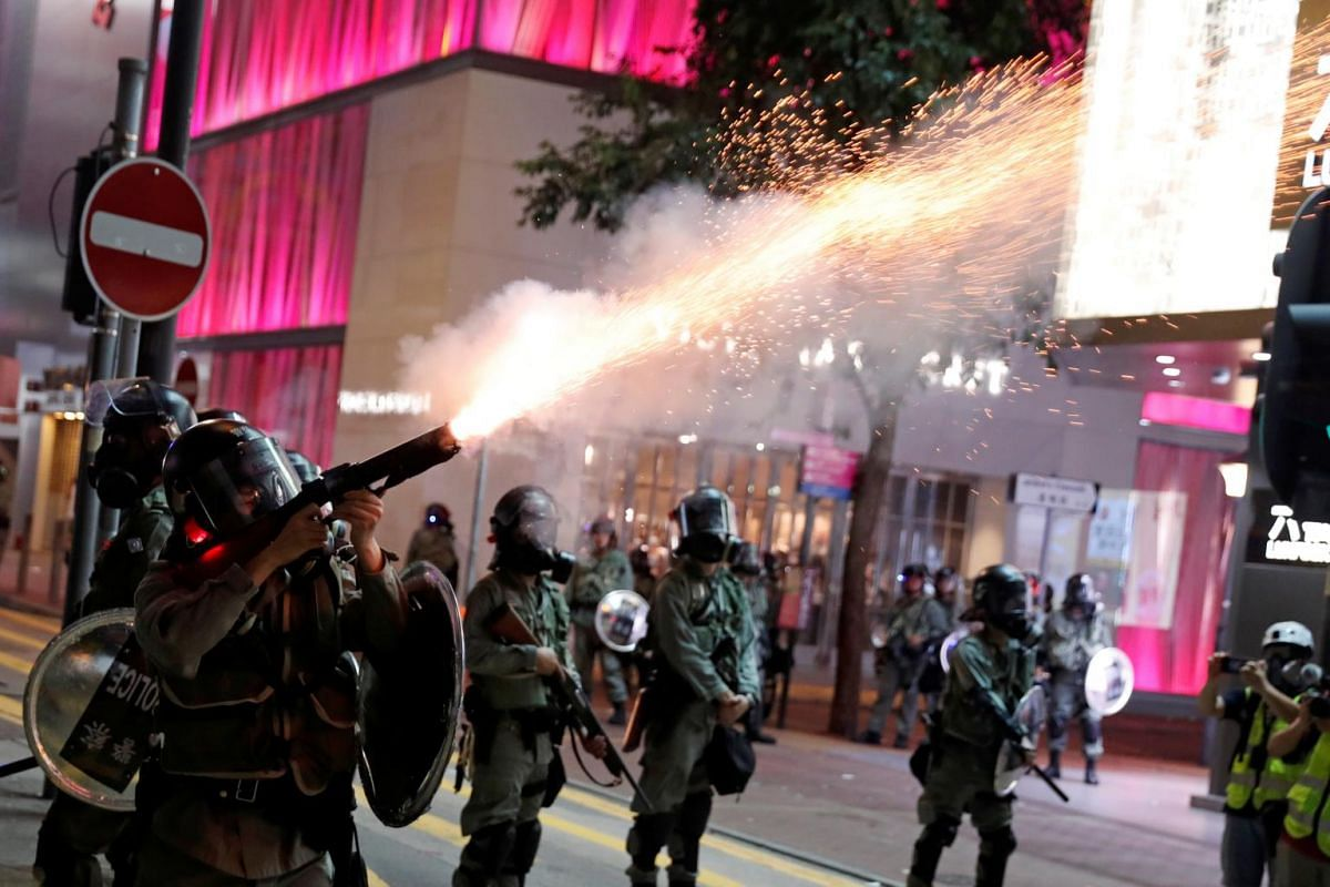 Riot police fire tear gas near Causeway Bay MTR station in Hong Kong, on Sept 8, 2019.