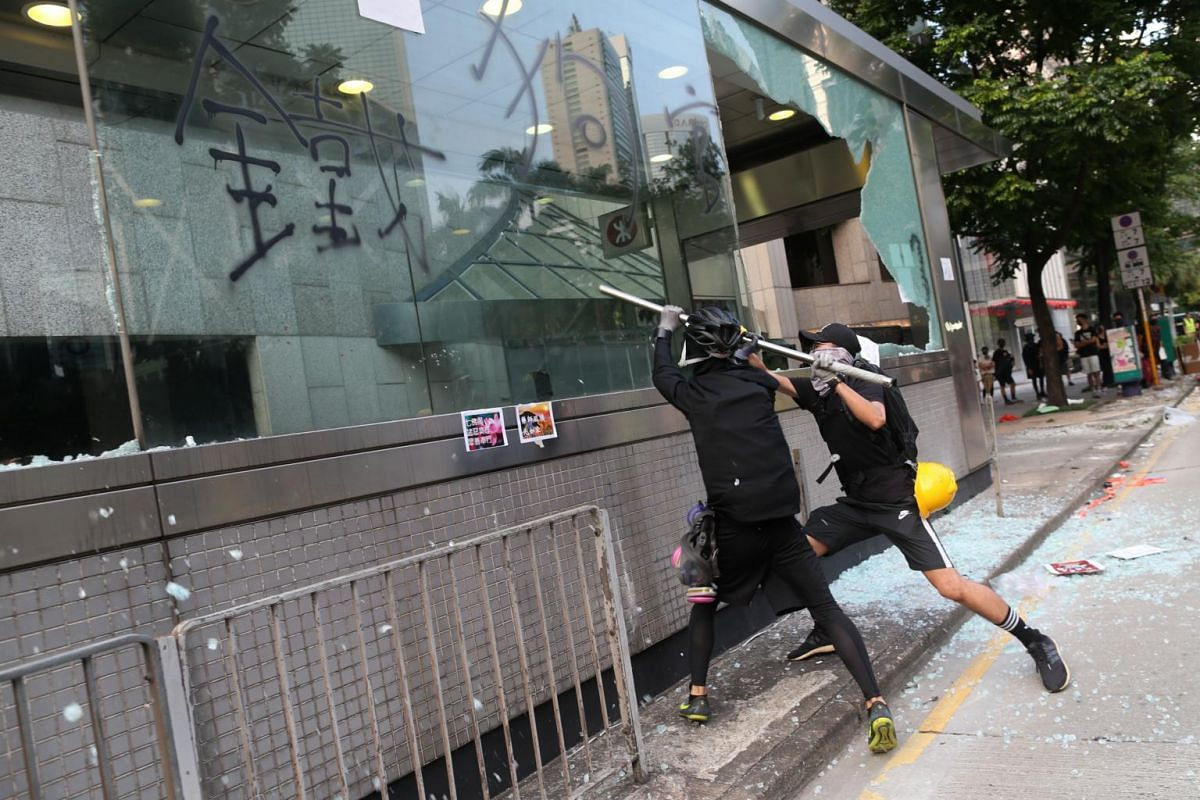 Protesters smash windows at the entrance of Central MTR station during a rally in Hong Kong, on Sept 8, 2019.