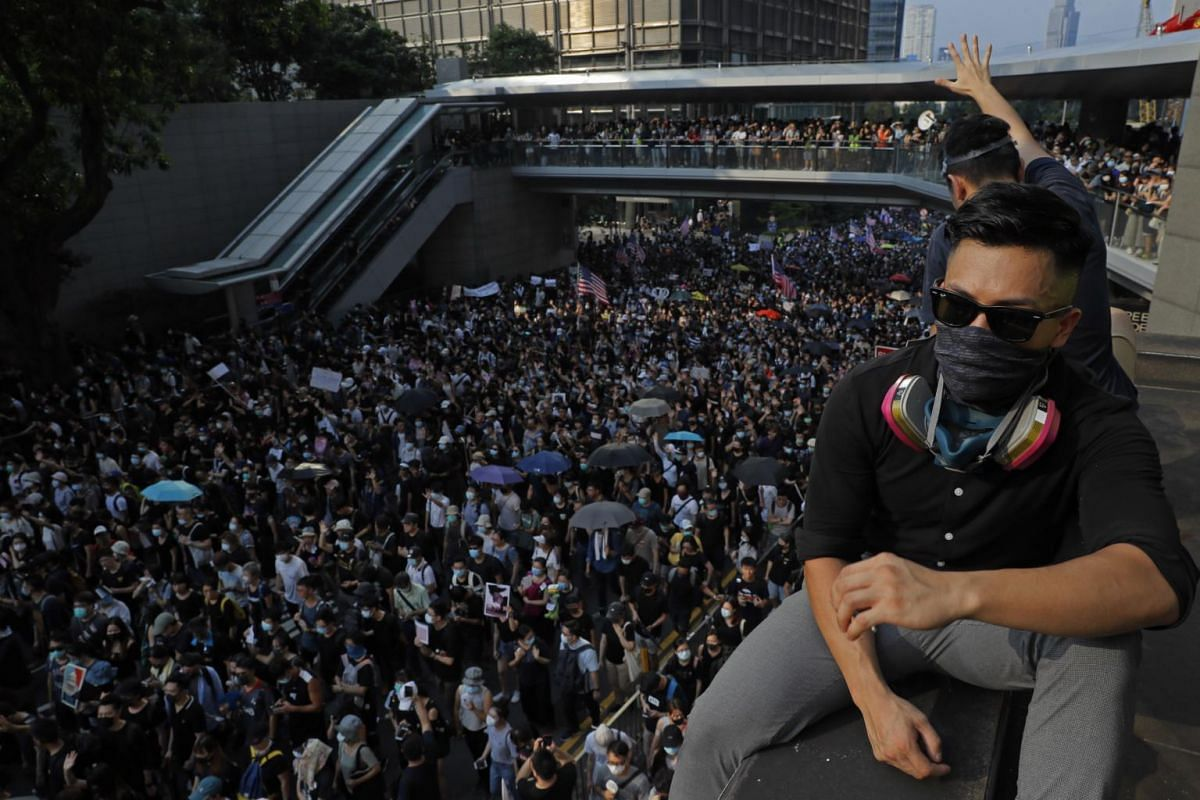 Protesters march from Chater Garden to the US Consulate in Hong Kong, on Sept 8, 2019.