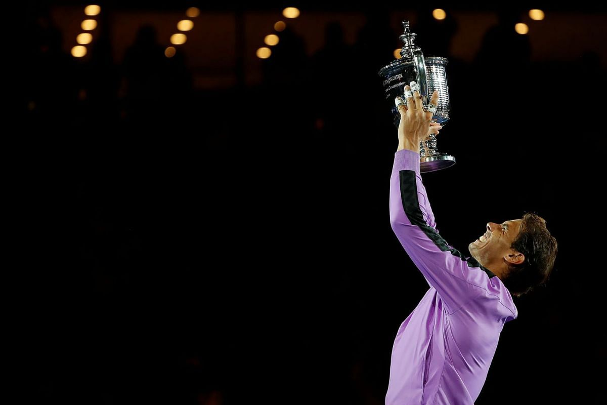 Rafael Nadal of Spain celebrates with the championship trophy during the ceremony after his match against Daniil Medvedev of Russia (not pictured) in the men's singles final on day fourteen of the 2019 US Open tennis tournament at USTA Billie Jean Ki