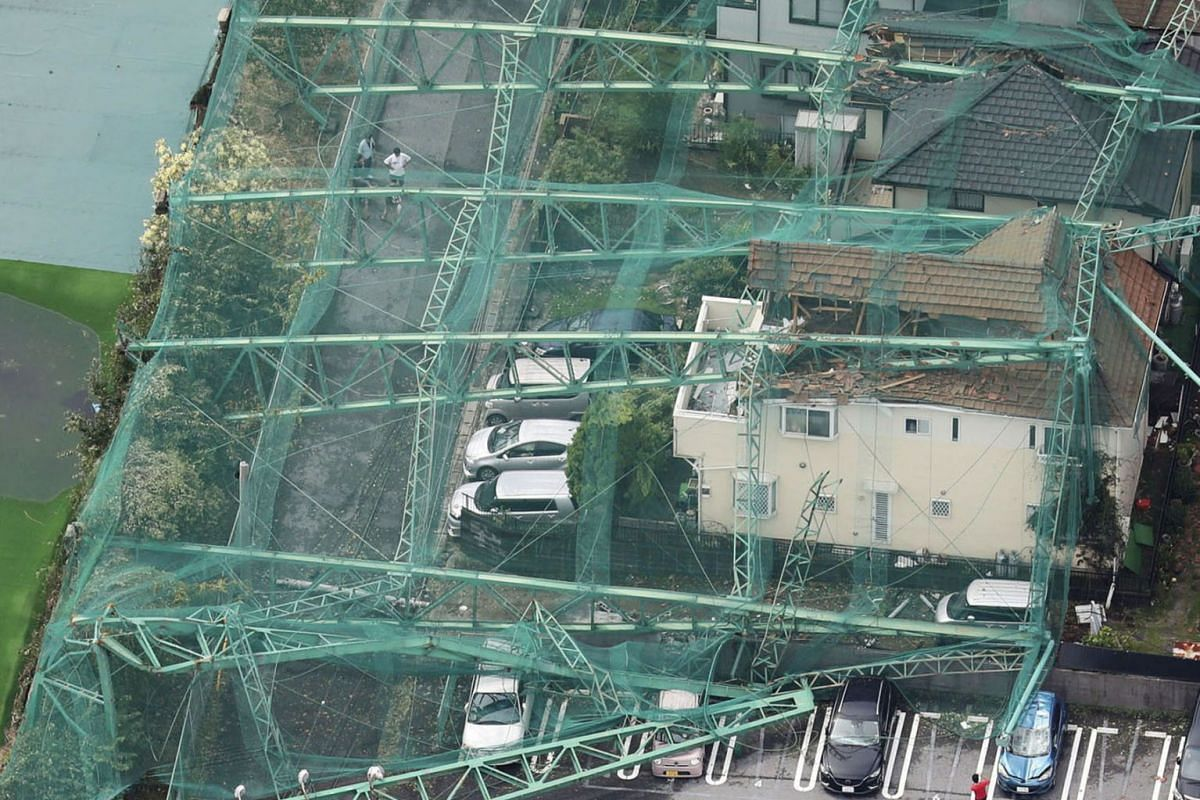 Houses and cars damaged by a collapse of the perimeter netting of a golf training field due to strong winds of Typhoon Faxai are seen in Ichihara, east of Tokyo, Japan September 9, 2019, in this photo taken by Kyodo. PHOTO VIA REUTERS
