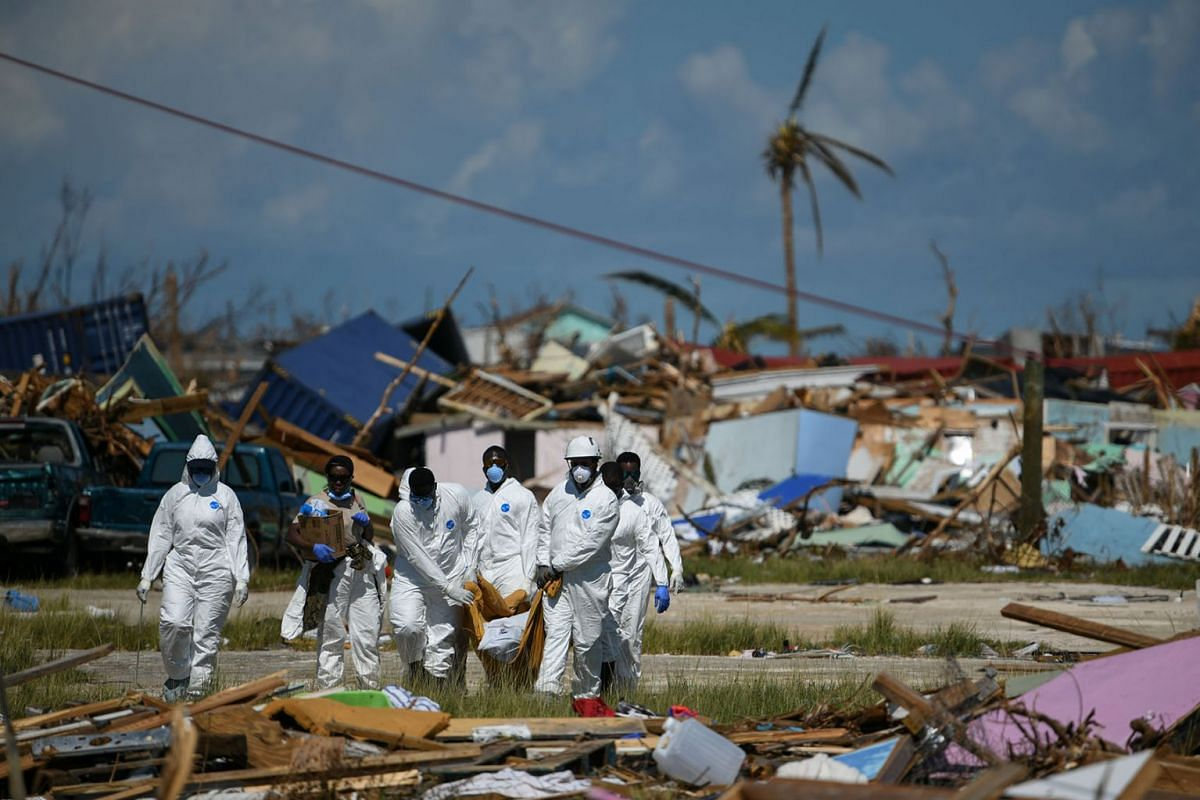 Personnel from the Royal Bahamas Police Force remove a body recovered in a destroyed neighbourhood in the wake of Hurricane Dorian in Marsh Harbour, Great Abaco, Bahamas, September 9, 2019. PHOTO: REUTERS