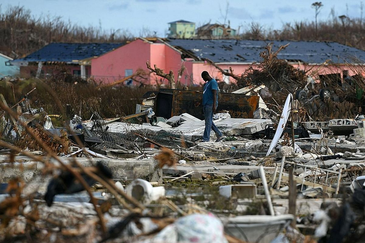 A man searching for his belongings among the debris in a neighbourhood destroyed by Hurricane Dorian in Marsh Harbour on the hardest-hit island of Great Abaco in the Bahamas on Sunday. Beach houses left destroyed after Typhoon Faxai hit the beachfron
