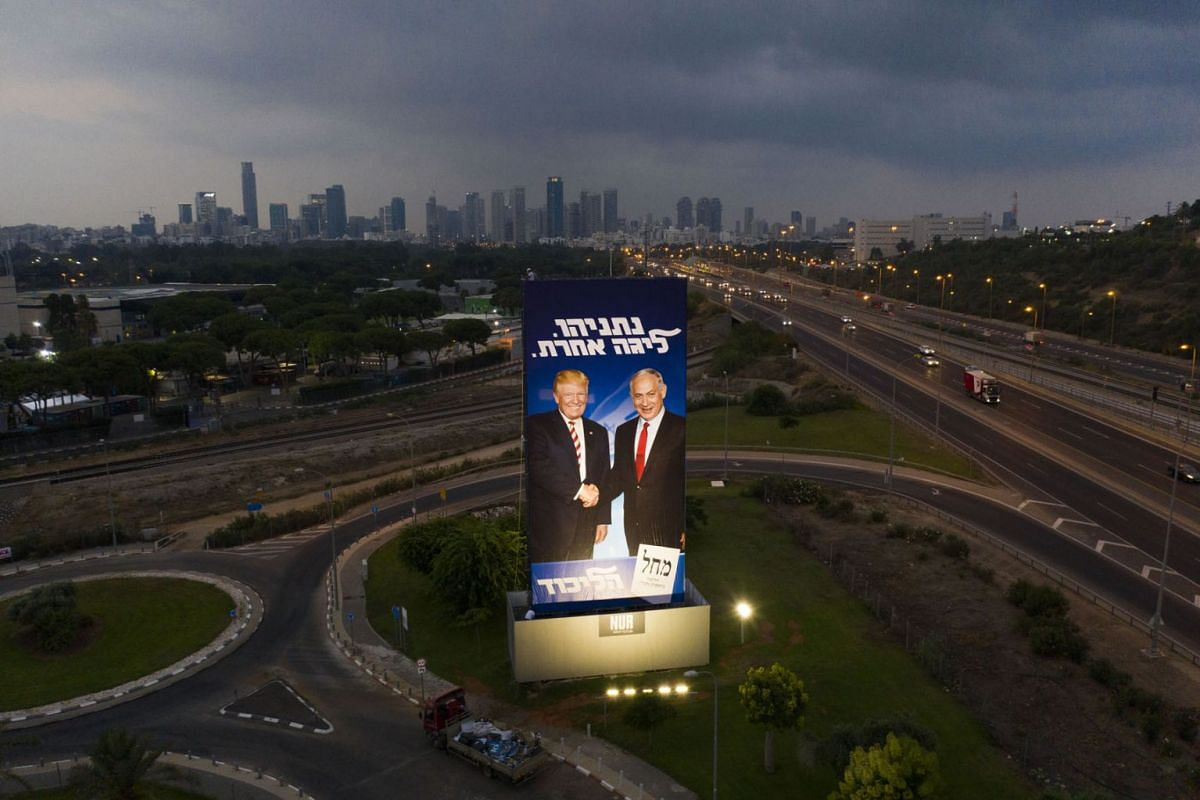 """A massive election campaign billboard of the Likud party shows Israeli Prime Minister Benjamin Netanyahu, right, and US President Donald Trump in Tel Aviv, Israel, Sunday, Sept 8, 2019. Hebrew on the billboard reads """"Netanyahu, in another league"""". PH"""