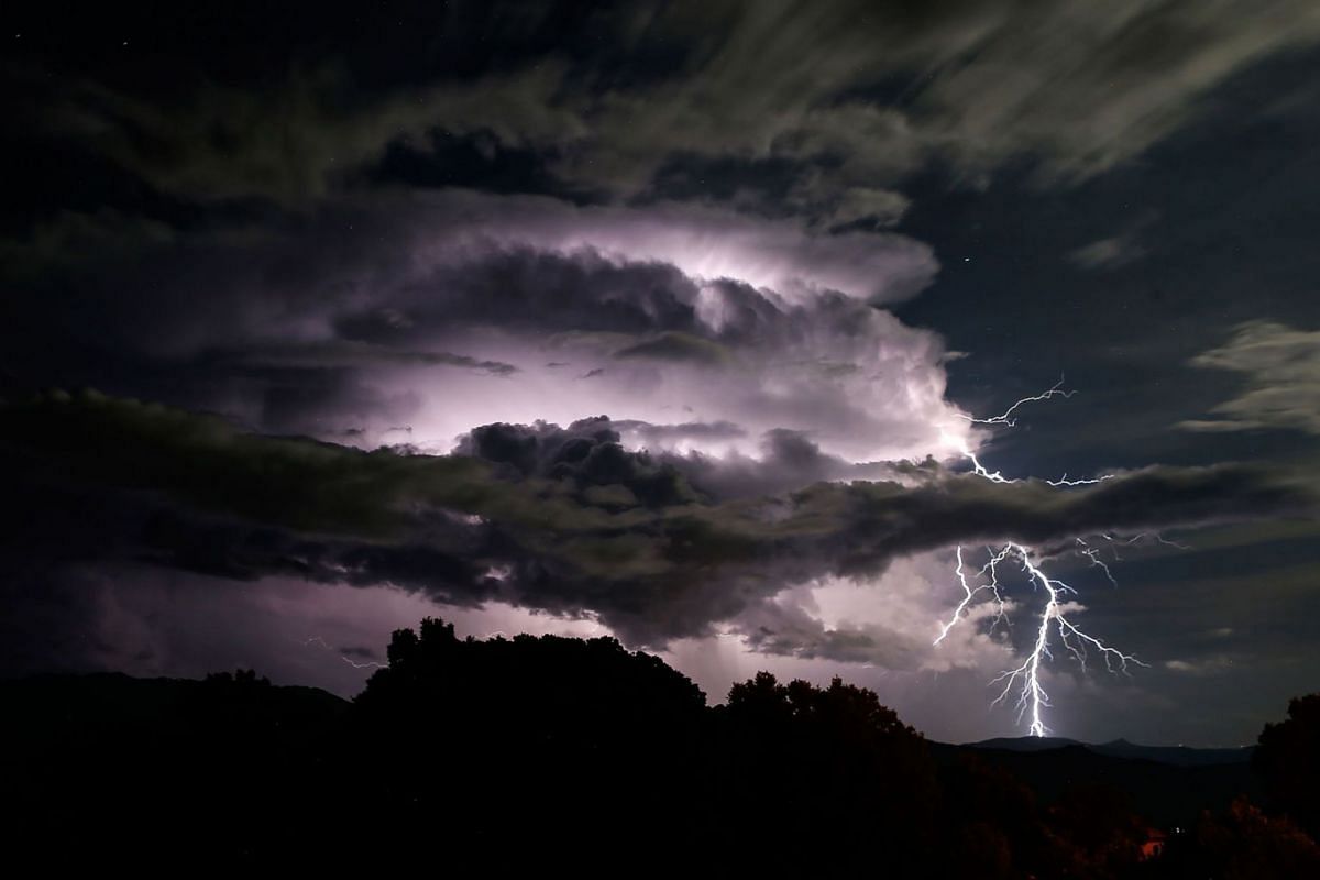 A picture taken on September 10, 2019 shows a lightning storm over the Taravo Valley in Cognocoli-Monticchi, on the French Mediterranean island of Corsica. PHOTO:  AFP