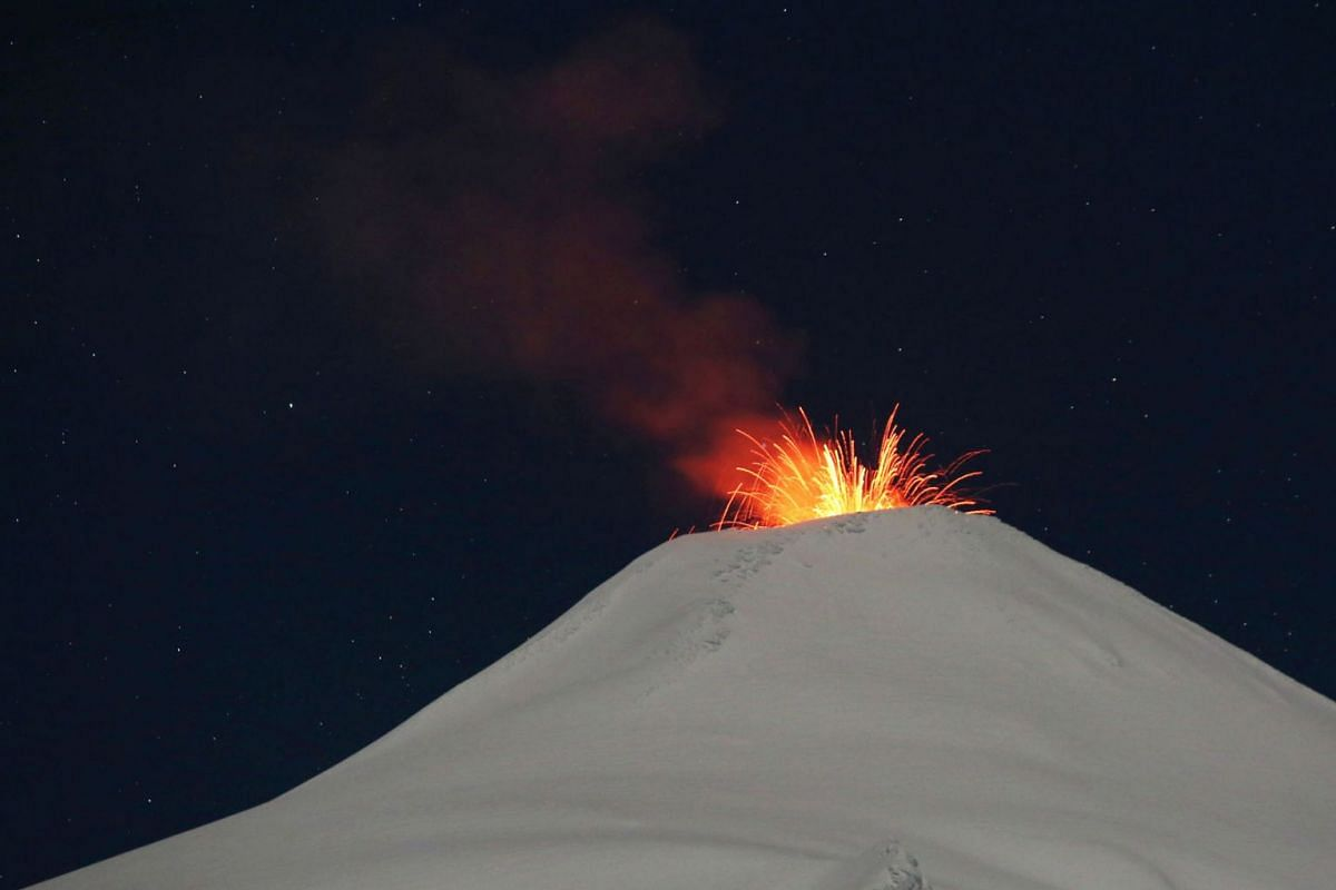The Villarrica volcano spews lava at night, as seen from the town of Pucon, Chile, September 11, 2019. PHOTO: REUTERS