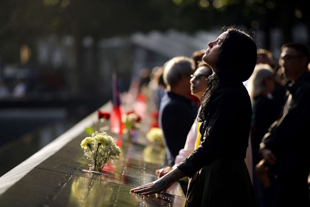 Alexandra Hamatie, whose cousin Robert Horohoe was killed on September 11, pauses at the National September 11 Memorial during a morning commemoration ceremony for the victims of the terrorist attacks 18 years after the day on September 11, 2019 in N