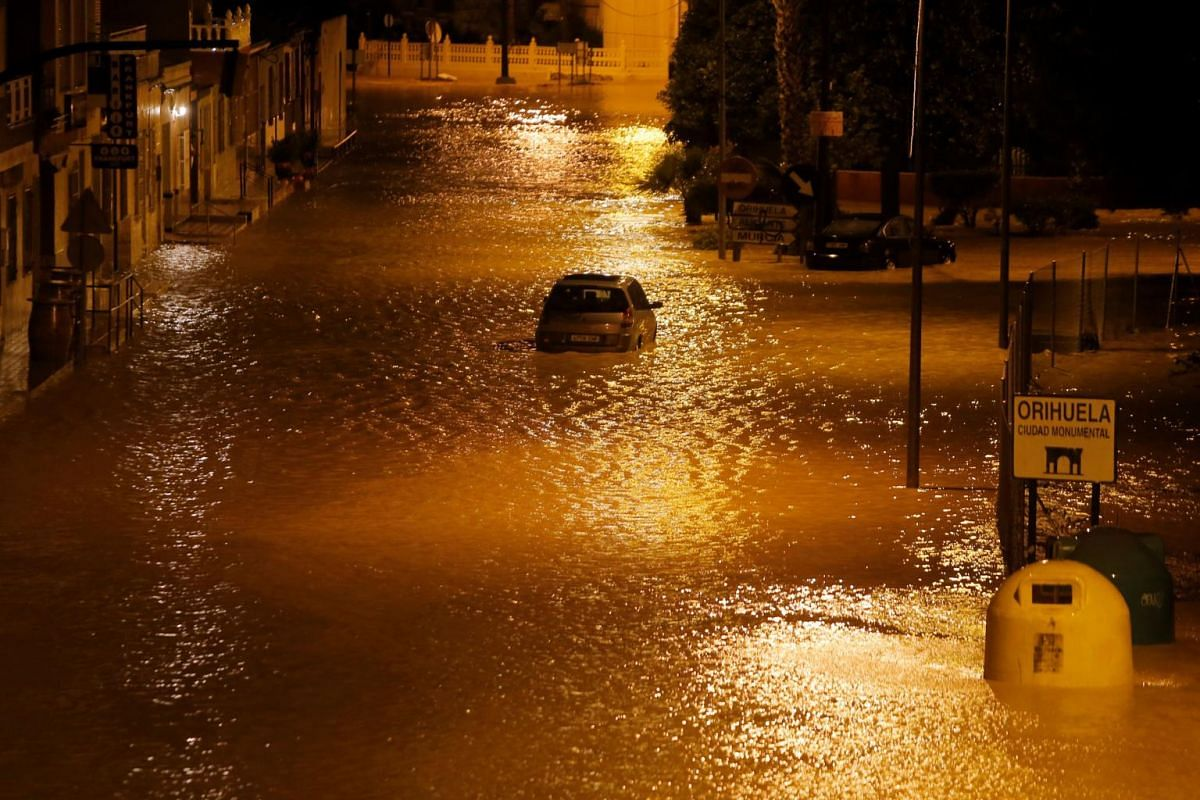 A car is stuck in a flooded street as torrential rains hit Orihuela, near Murcia, south-eastern Spain, on Sept 12, 2019.