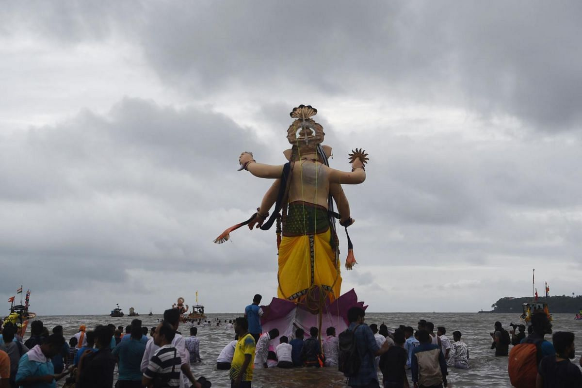 Indian devotees move a statue of the elephant-headed Hindu god Lord Ganesh to be immersed in the Arabian sea on the last day of the Ganesh Chaturthi festival in Mumbai, on Sept 12, 2019.