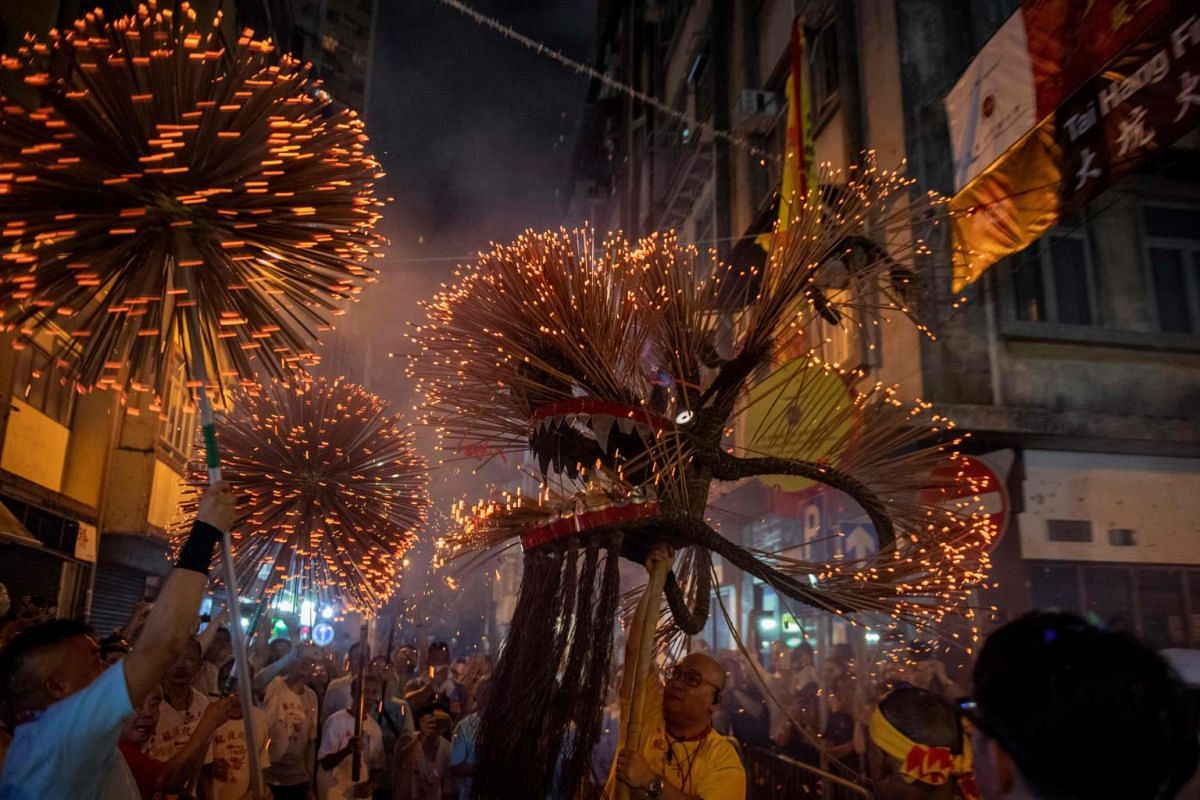 "A ""fire dragon"" has its head held up as participants take part in the annual Tai Hang ""fire dragon"" event, one of the highlights of the city's mid-autumn festival, in Hong Kong, on Sept 12, 2019."