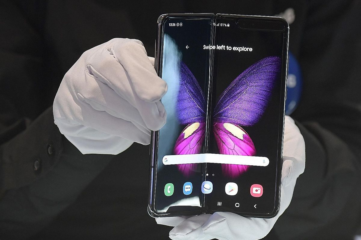The Samsung Galaxy Fold (right), which costs $3,088 in Singapore, was sold out here on its first day of sale last Wednesday.