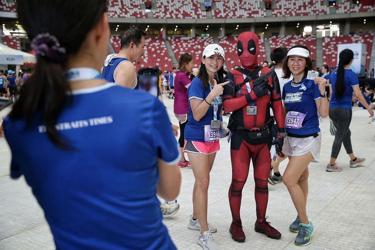 A participant dressed as Deadpool having his picture taken with other participants, on Sept 29, 2019.