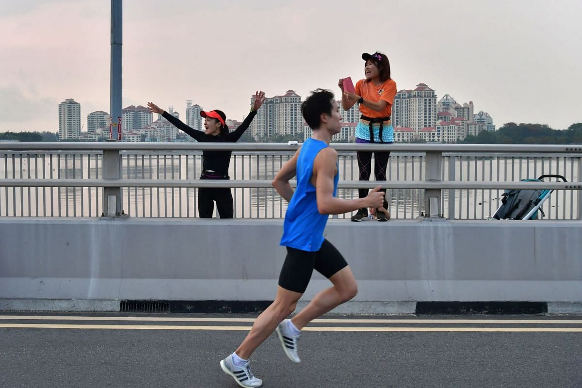 Japanese women on the Merdeka Bridge shouting out encouragement to runners of the 10km race.