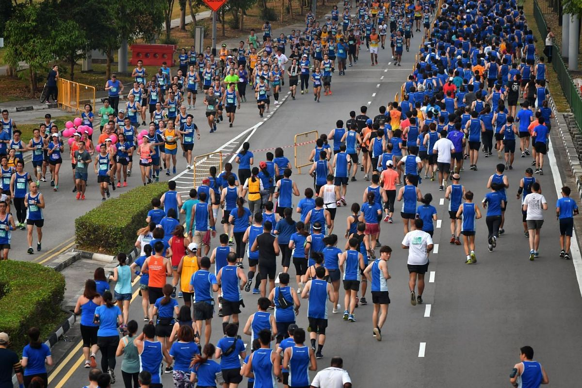 Participants of the 10km race making their way down Nicoll Highway.