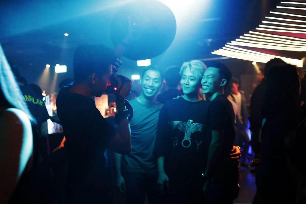 Other than taking photos of the DJs and the crowds, Mr Afiq also shoots individual partygoers using a portable light box. He has about three seconds to light and snap partygoers in the chaotic environment.