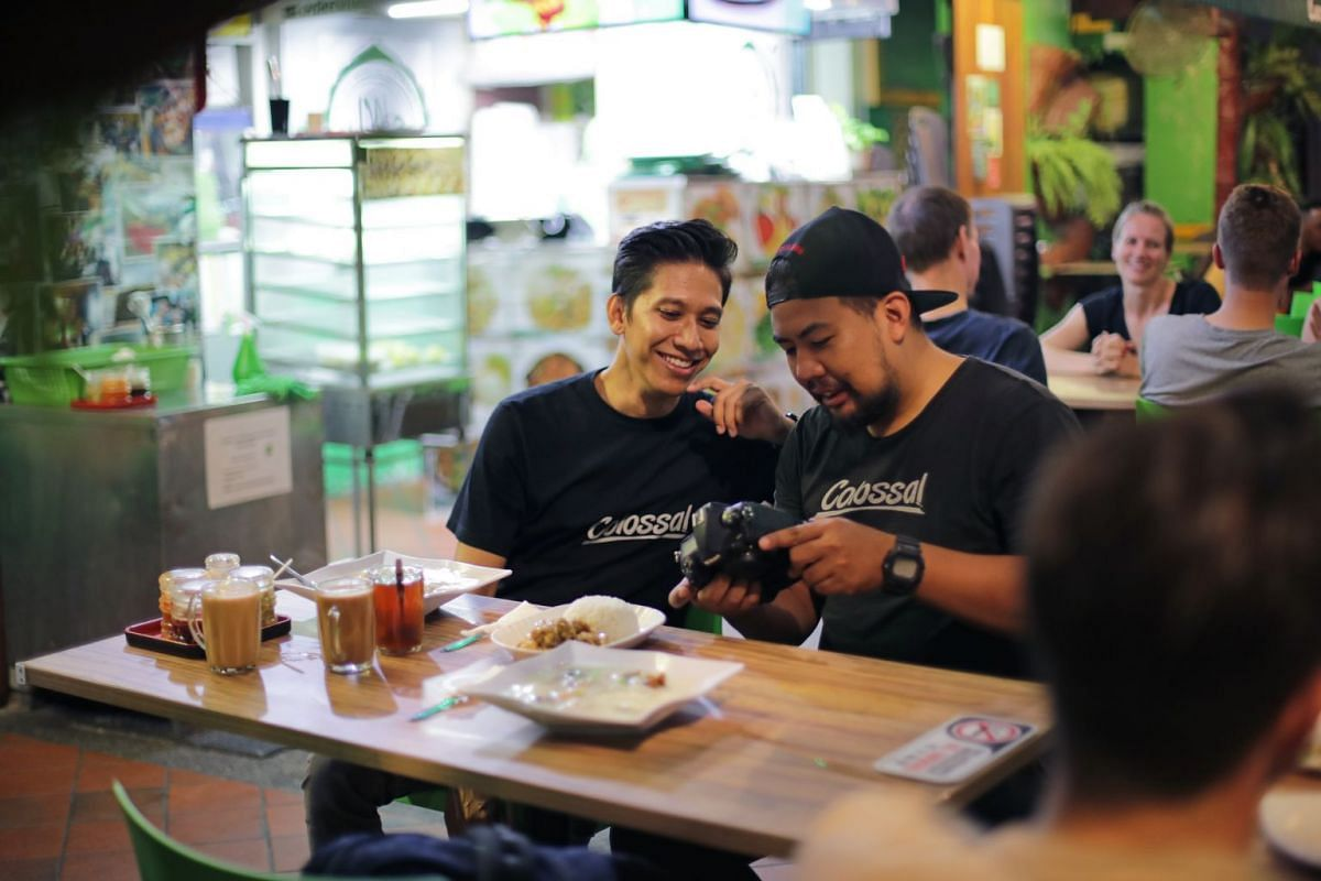 After a long shoot, Mr Afiq reconvenes with his team of photographers over supper at their usual spot, Lucky Cafe in North Bridge Road, to take stock of the day. Here, he is with team member Zack Jupri, who has just finished a shoot at Ce La Vi at Ma
