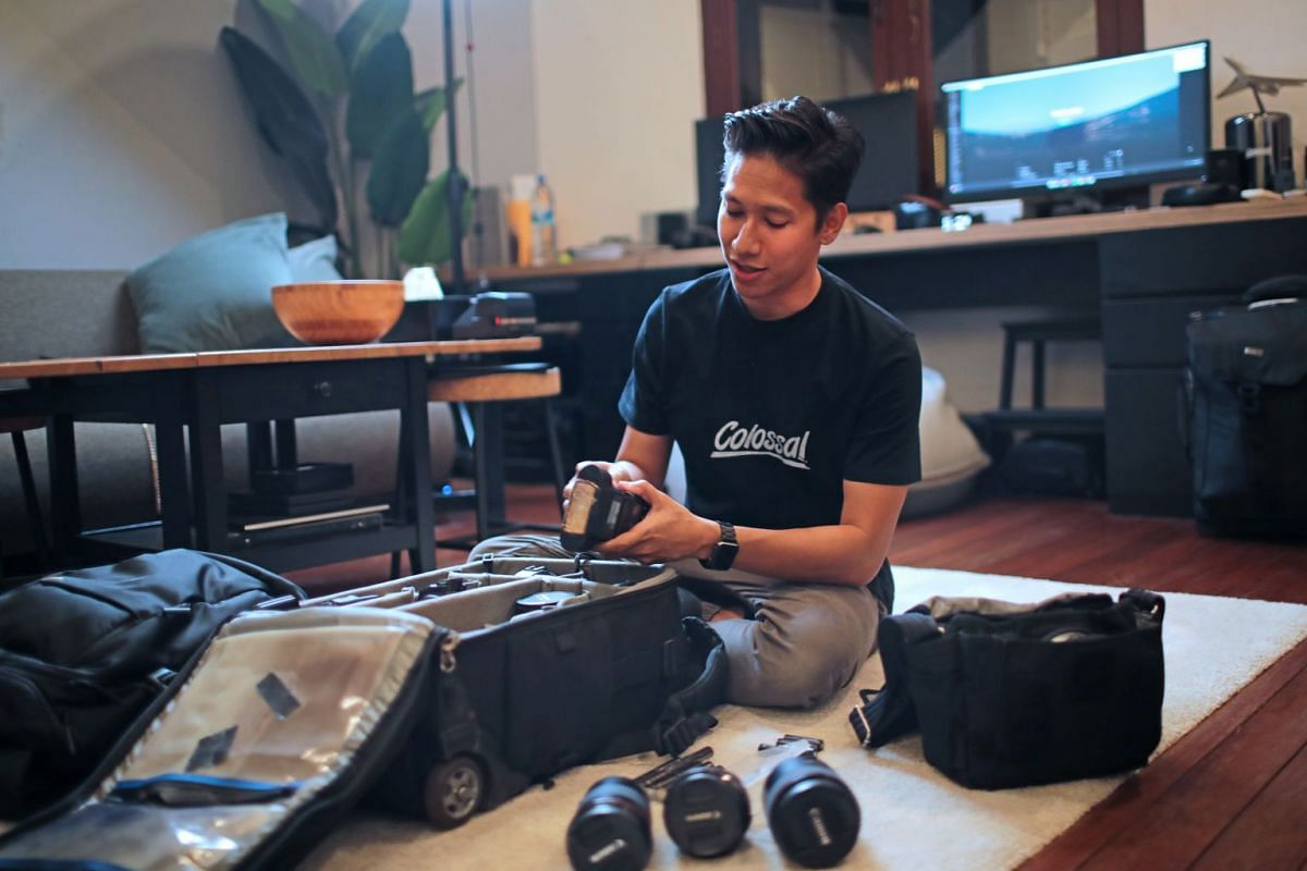 Founder of Colossal Photos Afiq Omar prepares his kit at his studio in Arab Street before heading to Zouk for a three-hour shoot.