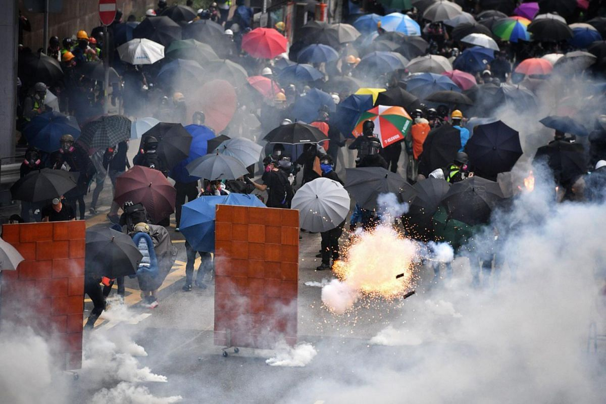 A tear gas canister explodes as protesters retreat near Lippo Centre, Hong Kong, on Sept 29, 2019.