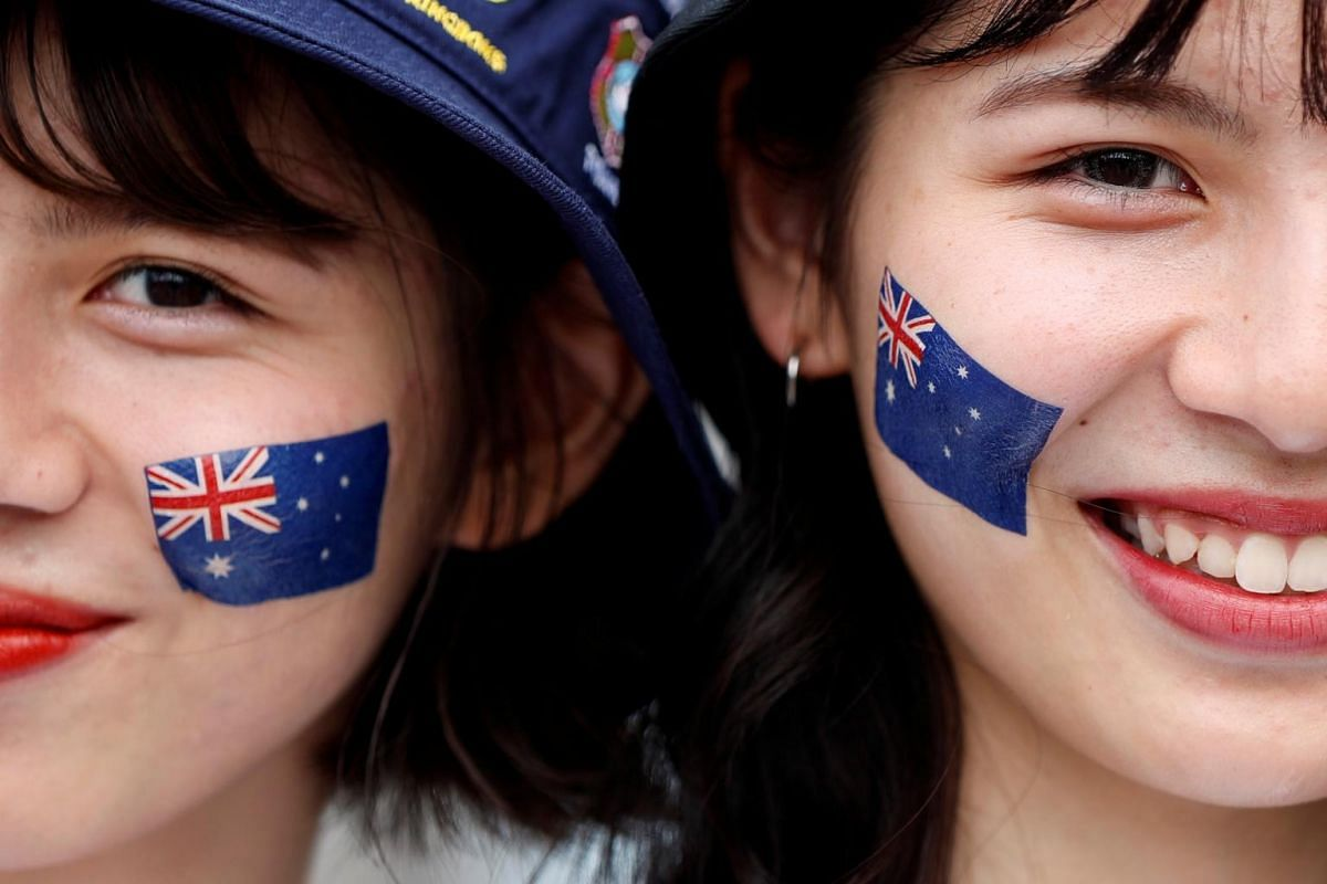 Australia fans smile before the Rugby World Cup match between Australia and Wales at the Tokyo Stadium in Japan on Sept 29, 2019.