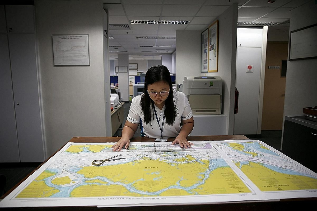Left: Ms Siti Nursyahirah Sumsuri, technical executive (Cartography), checks a completed nautical chart with the aid of a parallel ruler.