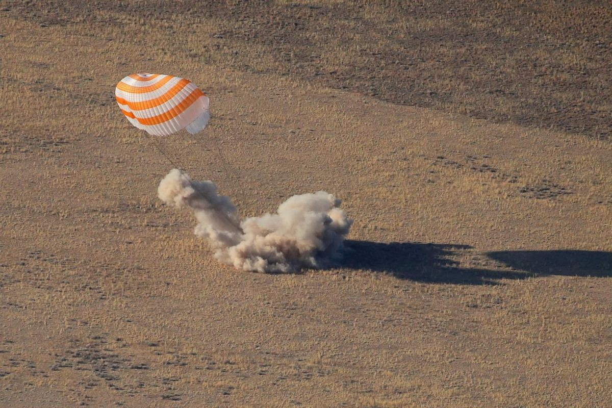 The Russian Soyuz MS-12 space capsule lands near the town of Zhezkazgan, Kazakhstan, on Oct 3, 2019. It was returning from a mission to the International Space Station with United States astronaut Nick Hague, Russian cosmonaut Alexey Ovchinin and Uni
