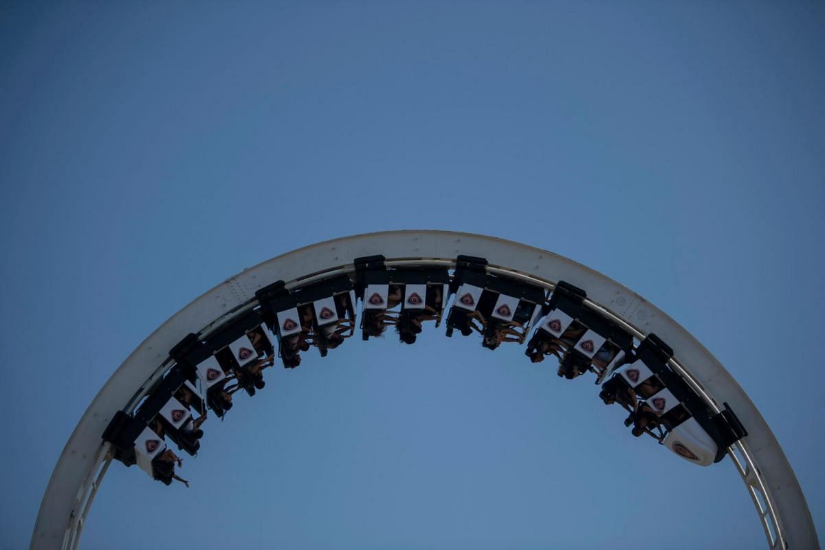 People take a ride in a roller coaster during the Rock in Rio festival at the Olympic Park in Rio de Janeiro, Brazil, on Oct 3, 2019.