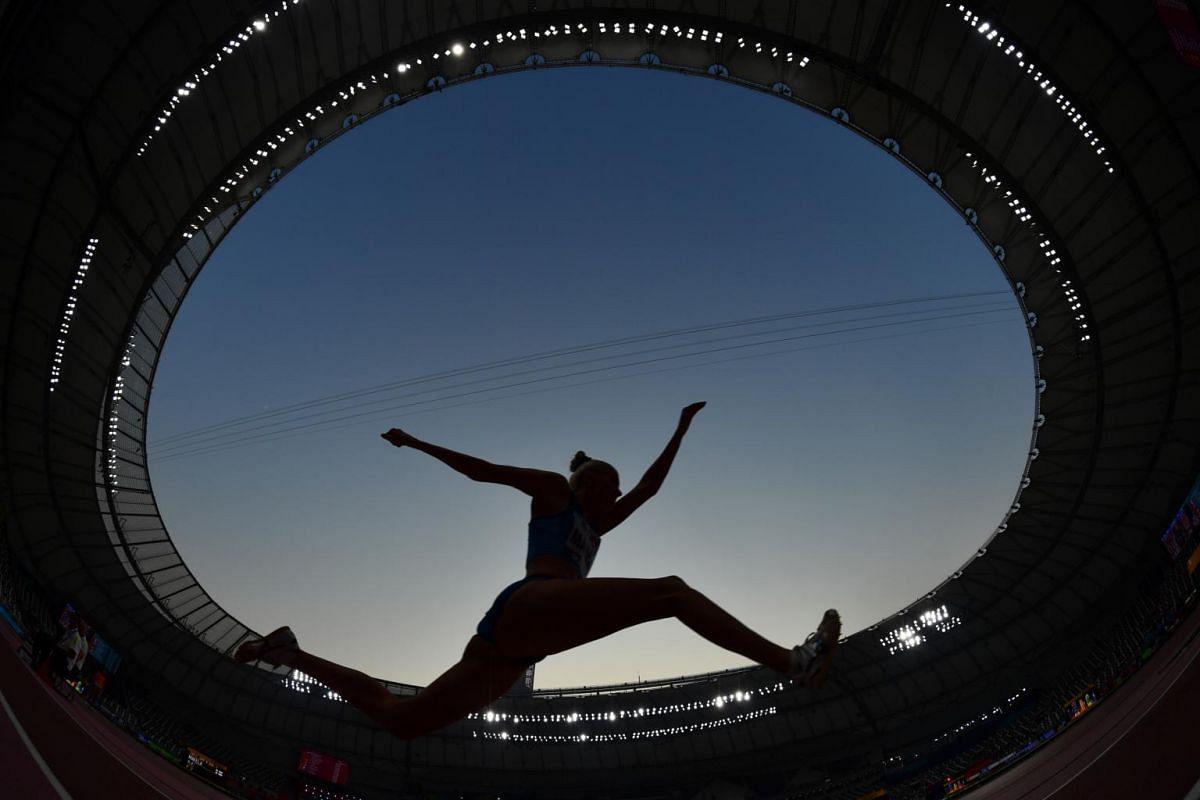 An athlete competes at the World Athletics Championships 2019 Women's Triple Jump Qualification in Khalifa International Stadium, Doha, Qatar, on Oct 3, 2019.